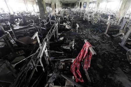 A scarf of a garment worker is seen in the burnt interior of garment factory Tazreen Fashions, after a devastating fire, in Savar November 28, 2012. REUTERS/Andrew Biraj
