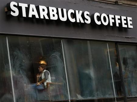 Patrons sit in a Starbucks Coffee shop in central London December 3, 2012. REUTERS/Andrew Winning