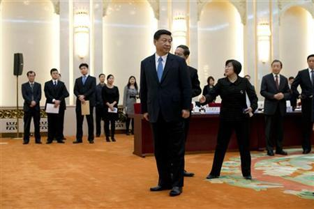 China's newly appointed leader Xi Jinping (C) prepares to greet a panel of foreign experts prior to a meeting at the Great Hall of the People in Beijing December 5, 2012. REUTERS/Ed Jones/Pool