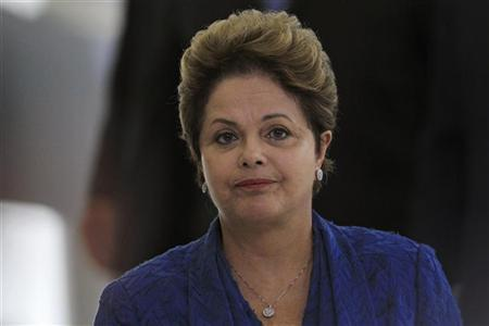 Brazil's President Dilma Rousseff attends a ceremony for the announcement of a port investment program at the Planalto Palace December 6, 2012. REUTERS/Ueslei Marcelino