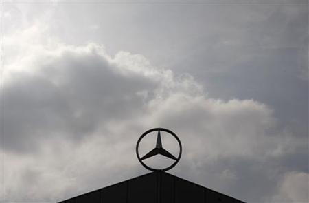 A Mercedes Benz logo is silhouetted against the sky at a newly completed factory of German car maker Daimler in Kecskemet, 90km (56 miles) east of Budapest March 2, 2012. REUTERS/Bernadett Szabo