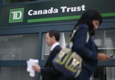 People walk past a Toronto Dominion Bank branch in Ottawa August 27, 2009. REUTERS/Chris Wattie