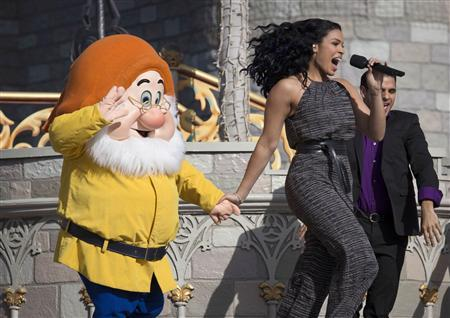 Singer Jordin Sparks performs with one of the Seven Dwarfs during the grand opening ceremony for Walt Disney World's new Fantasyland in Lake Buena Vista, Florida December 6, 2012. REUTERS/Scott Audette