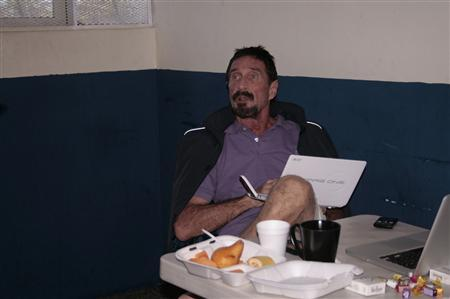 U.S. anti-virus software guru John McAfee uses a computer in a migrant shelter, where he is detained in Guatemala City, December 6, 2012. REUTERS/Human Rights Attorney/Handout