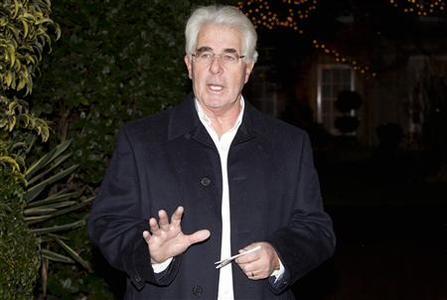 Publicist Max Clifford arrives at his home in Surrey after his arrest at Belgravia police station in central London December 6, 2012. REUTERS/Neil Hall