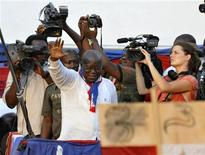 REFILE - CORRECTING DATE IN LAST SENTENCE Ghana's presidential candidate Nana Akufo-Addo (front C) of the opposition New Patriotic Party (NPP) waves during his last rally at Sutherland Addy Children's Park in Accra December 5, 2012. Ghana's cliff-hanger presidential election on Friday will test the country's reputation as a bulwark for democracy and economic growth in Africa's so-called coup-belt. The stakes are high with rivals jousting for a chance to oversee a boom in oil revenues that has brought hopes of increased development in a country where the average person makes less than $4 a day. Picture taken December 5, 2012. REUTERS/Luc Gnago