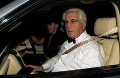 Publicist Max Clifford arrives for music and television mogul Simon Cowell's 50th birthday party celebration at Wrotham Park in Barnet, north London October 3, 2009. REUTERS/Luke MacGregor