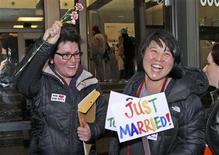 Junia Ribeiro (L), 51, and Patty Oh, 43, celebrate as they leave the King County Administration Building shortly after getting their marriage license in Seattle, Washington December 6, 2012. REUTERS/Marcus Donner