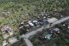 An aerial view of damaged houses caused by flash floods in Compostela Valley province, southern Philippines is seen in this handout photograph provided by the Philippine Army 10th Infantry Division December 6, 2012. Rescue workers searched on Thursday through thick mud, broken homes and fallen trees for survivors, two days after Typhoon Bopha swept the southern Philippines killing nearly 400 people and leaving at least as many missing. REUTERS/Philippine Army 10th Infantry Division