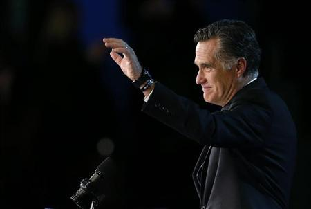 Republican presidential nominee Mitt Romney gestures as he gives his concession speech after losing the election to President Barack Obama, at Romney's election night rally in Boston, Massachusetts November 7, 2012. REUTERS/Jim Young