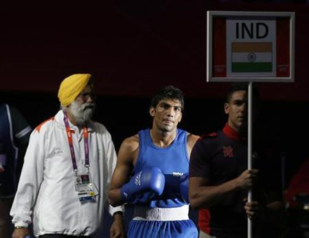 India's Manoj Kumar walks to the ring for his fight with Turkmenistan's Serdar Hudayberdiyev in the Men's Light Welter (64kg) Round of 32 boxing match during the London 2012 Olympic Games July 31, 2012. REUTERS/Murad Sezer/Files
