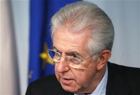 Italian Prime Minister Mario Monti attends a media conference at the Chigi palace in Rome December 6, 2012. Monti's government won a confidence vote in the lower house of parliament on Thursday but the centre-right party of former premier Silvio Berlusconi abstained after earlier walking out of a confidence vote in the Senate. REUTERS/Stefano Rellandini (ITALY - Tags: POLITICS)