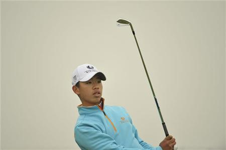 Guan Tian-Lang of China watches his shot during the Championship Pro-Am of the Volvo China Open at Binhai Lake Golf Club in Tianjin municipality, April 20, 2012. REUTERS/Paul Lakatos/OneAsia/Handout