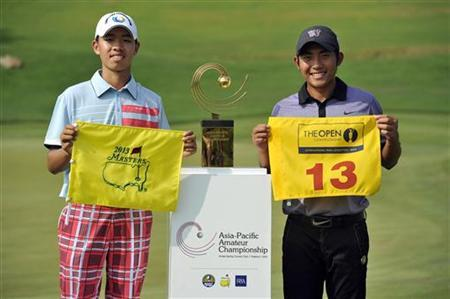 Winner Guan Tianlang of China (L) holds a certificate of invitation to the 2013 U.S. Masters Tournament as runner-up Pan Chung-Tseng of Taiwan poses with a certificate of entry to International Final Qualifying for the Open Championship, during the Asia-Pacific Amateur Championship at Amata Spring Country Club in Chonburi November 4, 2012. REUTERS/Paul Lakatos/OneAsia/Handout/Files