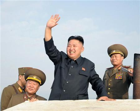 North Korean leader Kim Jong-Un (C) waves as he visits military units on islands in the most southwest of Pyongyang in this picture released by the North's official KCNA news agency in Pyongyang August 19, 2012. KCNA did not state precisely when the picture was taken. REUTERS/KCNA