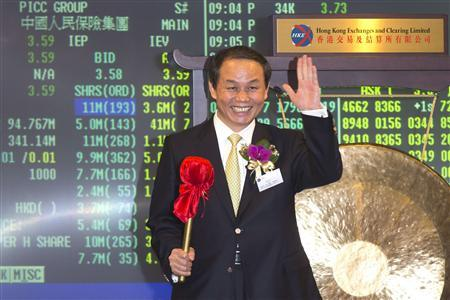 The People's Insurance Company (Group) of China Ltd (PICC) Group Chairman Wu Yan pose with a gong during the trading debut of the company at the Hong Kong Stock Exchange December 7, 2012. Shares in Chinese state-owned insurer PICC Group (1339.HK) surged in its Hong Kong trading debut on Friday, a lone bright spot in an otherwise dismal year for initial public offerings in the city and most other big regional markets. REUTERS/Tyrone Siu