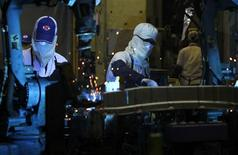 Employees work in an automobile spare parts factory in Ayutthaya province, north of Bangkok December 7, 2012. The emerging market boom that characterised the first decade of the millennium saw growth rates surge and profits multiply, but now countries such as Thailand, Indonesia and Malaysia face pressure from workers for a bigger share of the wealth. To match Analysis ASIA-WAGES/ REUTERS/Sukree Sukplang