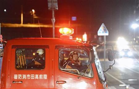 Firefighters persuade residents to evacuate after a strong earthquake hit the area in Rikuzentakata, Iwate prefecture, in this photo taken by Kyodo December 7, 2012. REUTERS/Kyodo