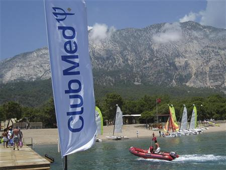 A Club Med banner blows in the wind on the dock at the Club Med Beldi vacation resort in Beldibi June 22, 2009. REUTERS/John Schults
