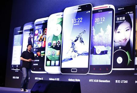 Lei Jun, founder and CEO of China's mobile company Xiaomi, speaks at a launch ceremony of Xiaomi Phone 2 in Beijing in this August 16, 2012 file photo. REUTERS/Jason Lee/Files