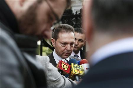 Greece's Finance Minister Yannis Stournaras makes statements after a meeting with Greek President Karolos Papoulias (unseen) at the Presidential palace in Athens December 5, 2012. REUTERS/Yorgos Karahalis