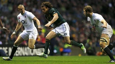 Joe Launchbury (R) and Mike Brown of England close in as Zane Kirchner of South Africa runs with the ball during their international rugby match at Twickenham, London November 24, 2012. REUTERS/Eddie Keogh