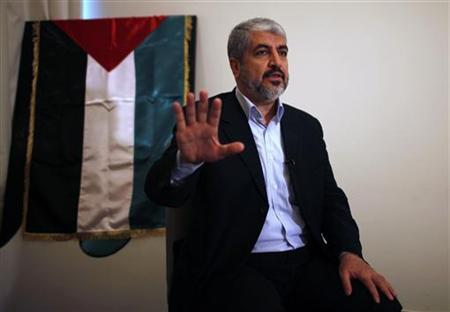 Hamas leader Khaled Meshaal talks during his interview with Reuters in Doha November 29, 2012. REUTERS/Ahmed Jadallah