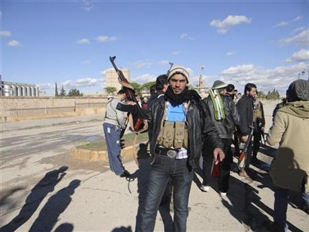 Free Syrian Army fighters are seen at the town of Ras al-Ain, near the province of Hasaka, 600 km (373 miles) from Damascus December 5, 2012. REUTERS/Samer Abdullah/Shaam News Network/Handout