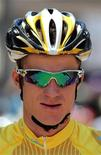 Michael Rogers sits wearing the leader's golden jersey at the start line for the eighth and final stage of the Tour of California cycling race in Westlake Village, California May 23, 2010. REUTERS/Anthony Bolante