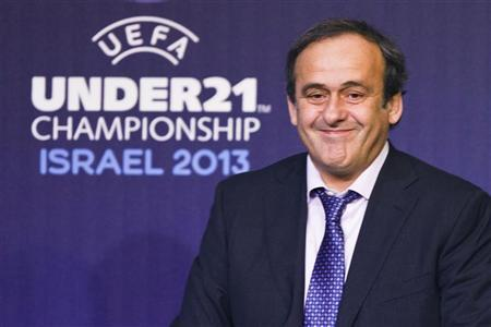 UEFA President Michel Platini smiles during a draw ceremony for the 2013 UEFA European Under-21 Championship in Tel Aviv November 28, 2012. REUTERS/Nir Elias