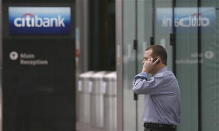 A man speaks on a mobile phone outside Citibank's offices in the Canary Wharf district of London January 16, 2009. REUTERS/Andrew Winning