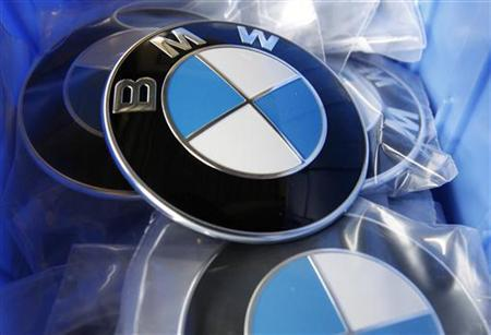 BMW luxury car logo's are pictured in a spare part store at a BMW garage in Niderwangen near Bern, May 24, 2012. REUTERS/Pascal Lauener (SWITZERLAND - Tags: POLITICS BUSINESS)