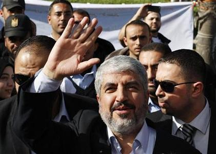 Hamas chief Khaled Meshaal waves upon arrival at Rafah crossing in the southern Gaza Strip December 7, 2012. Meshaal arrived in the Gaza Strip on Friday, ending 45 years of exile from Palestinian land with a visit that underscored the Islamist group's growing confidence following a recent conflict with Israel. REUTERS/Suhaib Salem