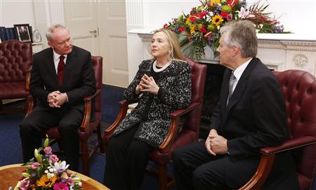 U.S. Secretary of State Hillary Clinton meets with Northern Ireland's First Minister Peter Robinson (R) and Deputy First Minister Martin McGuinness (L) at Stormont Castle in Belfast December 7, 2012. Clinton travelled to Northern Ireland on Friday to lend her support to the British province's fragile peace, the frailty of which was underlined by overnight rioting on the eve of her visit and the seizure of a bomb. REUTERS/Kevin Lamarque
