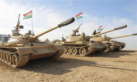 Kurdish Peshmerga troops and tanks are deployed on the outskirts of Kirkuk, some 250km (155 miles) north of Baghdad December 3, 2012. Iraq's Kurdish region has sent reinforcements to a disputed area where its troops are involved in a standoff with the Iraqi army, a senior Kurdish military official said, despite calls on both sides for dialogue to calm the situation. Picture taken December 3, 2012. REUTERS/Ako Rasheed
