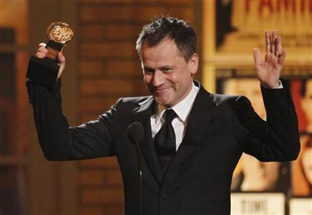 Theatre director Michael Grandage accepts his award for Best Direction of a Play for works in ''Red'' at the American Theatre Wing's 64th annual Tony Awards ceremony in New York June 13, 2010. REUTERS/Gary Hershorn/Files