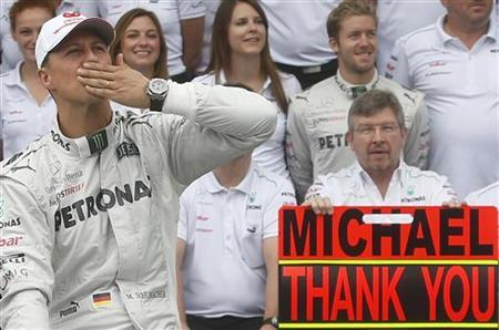 Mercedes Formula One driver Michael Schumacher of Germany gestures during a photo call before the Brazilian F1 Grand Prix at Interlagos circuit in Sao Paulo November 25, 2012. REUTERS/Ricardo Moraes