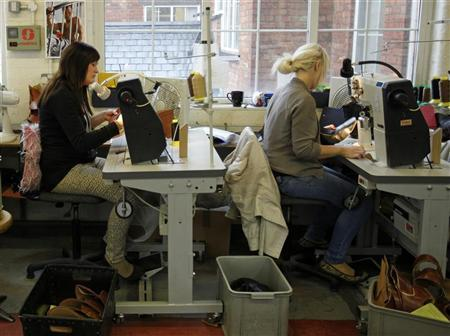 Workers sew shoes at a shoe factory in Northampton, central England, April 25, 2012. REUTERS/Darren Staples