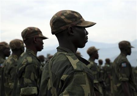A government army FARDC soldier stands in a formation during a briefing by their commander in the town of Sake, some 27 km (17 miles) west of Goma December 3, 2012. REUTERS/Goran Tomasevic