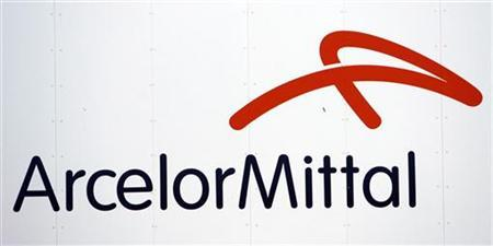 A logo of ArcelorMittal steel group is seen at the Les Chantiers de l'Atlantique shipyards in Saint Nazaire, western France, July 9, 2009. REUTERS/Stephane Mahe