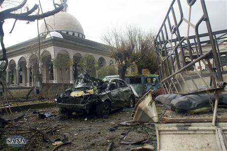 Damaged cars are pictured after a bomb explosion near Quba mosque in Homs city December 7, 2012, in this handout photograph released by Syria's national news agency SANA. SANA said 15 were wounded by a ''terrorist bomb'' in Homs. REUTERS/Sana/Handout
