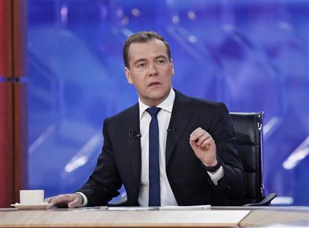 Russia's Prime Minister Dmitry Medvedev speaks during his interview with national television channels in Moscow December 7, 2012. REUTERS/Dmitry Astakhov/RIA Novosti/Pool