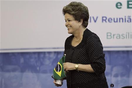 Brazil's President Dilma Rousseff leaves the president's chair after passing the presidency of the Mercosur to Uruguay's President Jose Mujica (not pictured) during the Summit of Heads of State of Mercosur and Associated States and the 44th Meeting of the Common Market Council at the Itamaraty Palace in Brasilia December 7, 2012. REUTERS/Ueslei Marcelino