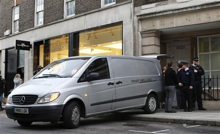 A private ambulance is loaded with a body at the block of flats where the nurse Jacintha Saldanha lived near the King Edward VII Hospital in central London on December 7, 2012. REUTERS/Olivia Harris