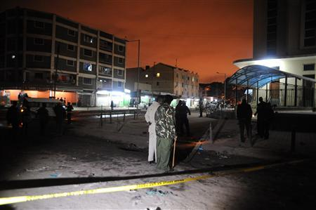 Policemen inspect the secured section at the scene of the blast in Eastleigh suburb of Kenya's capital Nairobi December 7, 2012. REUTERS/Stringer