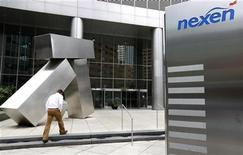 A man walks into the Nexen building in downtown Calgary, Alberta, July 23, 2012. REUTERS/Todd Korol