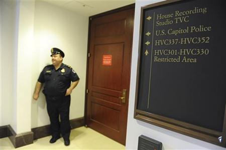 U.S. Capitol Police guard a door to the restricted area where former CIA Director David Petraeus is testifying, at Capitol Hill in Washington November 16, 2012. REUTERS/Mary F. Calvert