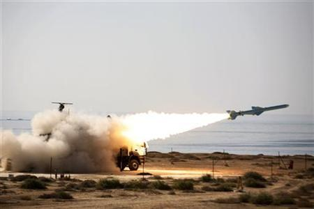An Iranian long-range shore-to-sea missile called Qader (Capable) is launched during Velayat-90 war game on Sea of Oman's shore near the Strait of Hormuz in southern Iran January 2, 2012. REUTERS/Jamejamonline/Ebrahim Norouzi/Handout