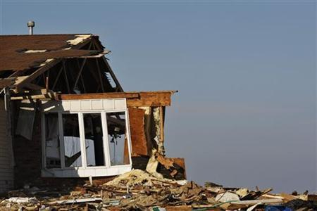 The debris of a home damaged by Superstorm Sandy is seen one month after the disaster at the zone of Union Beach in New Jersey November 29, 2012. REUTERS/Eduardo Munoz.