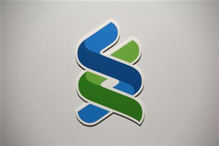 A company logo of Standard Chartered bank is displayed during a news conference in Hong Kong April 29, 2010. REUTERS/Bobby Yip